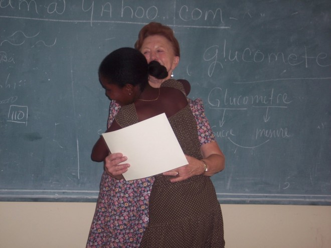Gail with student in Haiti